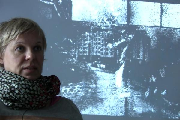 Mia Mäkelä interviewed in front of projection