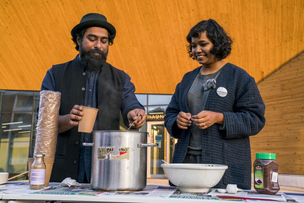 Partizaning Maunula, Ali and Vidha serving soup at the event
